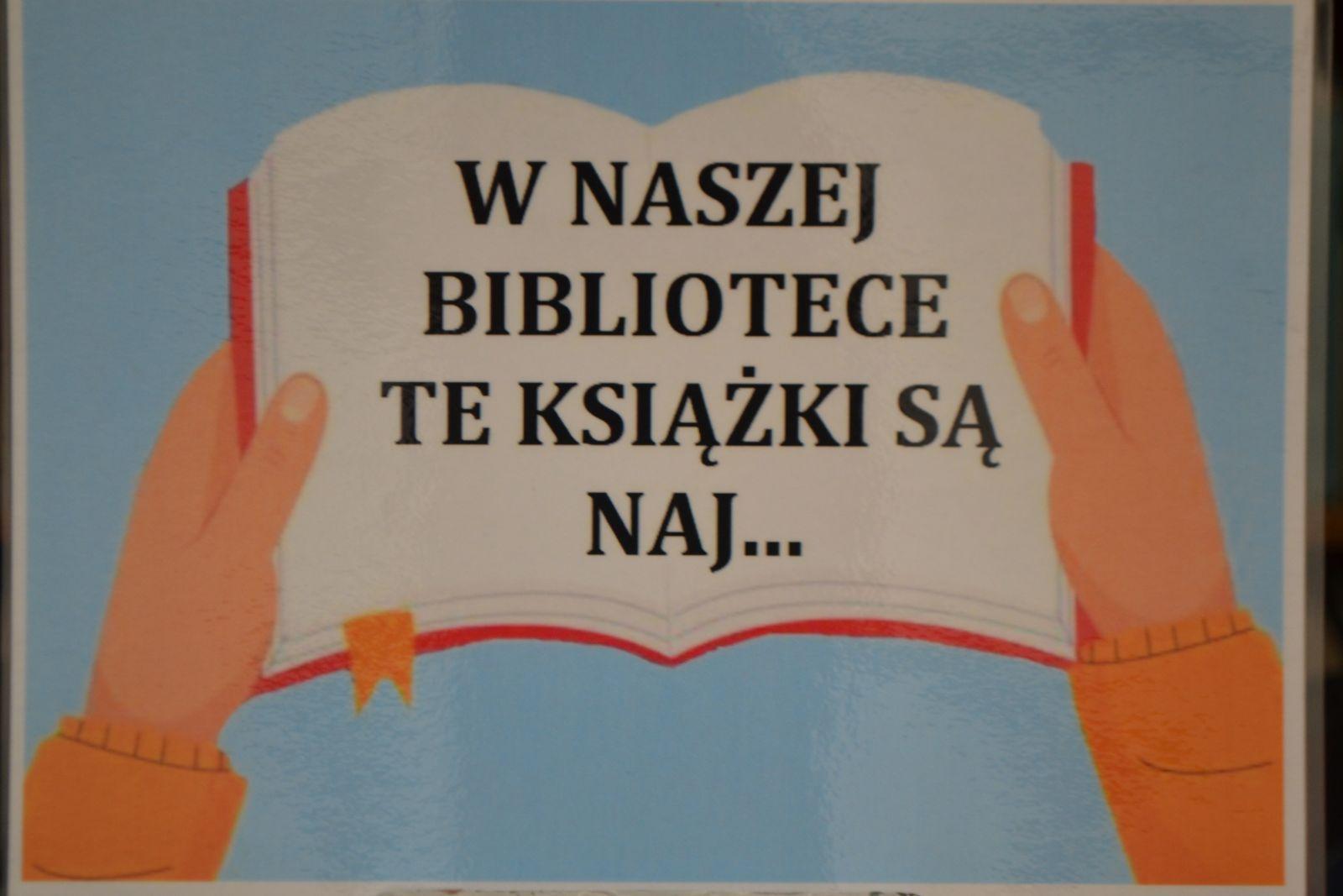 Ilustracja przedstawiająca rozłożoną w dłoniach książkę, w środku napis: W naszej bibliotece te książki są naj...